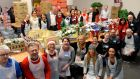 Staff at the goodie bag area at the Knights of Columbanus homeless dinne at the RDS today. Photograph: Cyril Byrne/The Irish Times