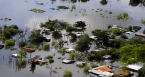 More than 100,000 people have had to evacuate from their homes in the bordering areas of Paraguay, Uruguay, Brazil and Argentina due to severe flooding. Photograph: Jorge Adorno/Reuters