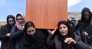 Independent Afghan civil society activist women carry the coffin of Farkhunda. Photograph: Wakil Kohsar/AFP/Getty Images