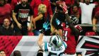 Julio Jones of the Atlanta Falcons rises above Luke Kuechly of the Carolina Panthers to make the game-winning touchdown at the Georgia Dome that ended the Panthers' unbeaten season. Photograph: Scott Cunningham/Getty Images