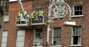 A building on North Great Frederick Street in Dublin is treated by workers. Photograph: Cyril Byrne