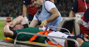 Paul O'Connell is stretchered off at half-time after receiving a serious leg injury during Ireland's pool match against France at the Millennium Stadium, Cardiff. Photograph: David Davies/PA Wire.