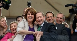 Taoiseach Enda Kenny  and Tánaiste Joan Burton with Ministers in the courtyard at Dublin Castle for the results of the referendum on same-sex marriage. Photograph: Dara Mac Dónaill/The Irish Times