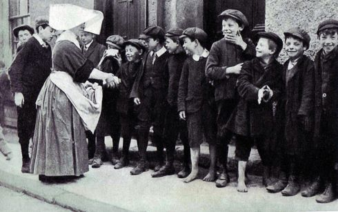 Food shortages became a major problem for Dubliners as the week progressed. In this image a Catholic nun feeds working-class youths in the city centre.
