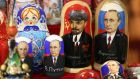 Souvenir matryoshka dolls featuring Vladimir Lenin, former Communist Party founder, center, and Vladimir Putin, Russia's president, right, sit for sale at a kiosk on Red Square in Moscow . Photographer: Andrey Rudakov/Bloomberg