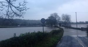 The Lee Rd near Carrigrohane which is impassable due to flooding on Wednesday after Storm Frank brought heavy rainfall to the area. At least four vehicles are reportedly stranded on the flooded road.  Photograph: Random Cork Stuff  via Twitter
