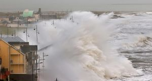 A massive wave breaks over the promenade at Tramore, Co Waterford at high tide on Wednesday morning as Storm Frank hit the popular seaside resort. Photograph: Noel Browne
