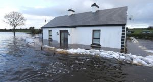 AFTER: The sandbag defences failed to stop Ann Conolly's house from flooding at Ballinastague, Co Galway, December 30th, 2015. Photograph: Joe O'Shaughnessy