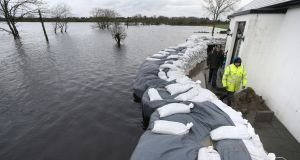 BEFORE: Ann Connolly's house  at Ballinastague, Co Galway,  on Monday of this   week with sandbags  in place in a bid to stem floodwaters.  Photograph: Joe O'Shaughnessy.