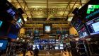 Traders work on the floor of the New York Stock Exchange. Photograph: Michael Nagle/Bloomberg