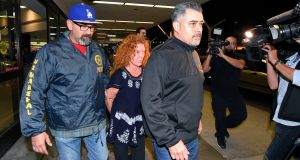 Tonya Couch is taken by authorities  to a waiting car after arriving at Los Angeles International Airport, Thursday, December 31st, 2015, in Los Angeles.  Photograph: Mark J Terrill/AP Photo