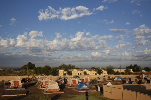 "Clouds pass above Camp Hope in Las Cruces, New Mexico.  Camp Hope, with 50 residents, describe themselves as ""alternative transitional living project for the homeless"".  Photograph:Shannon Stapleton/REUTERS"