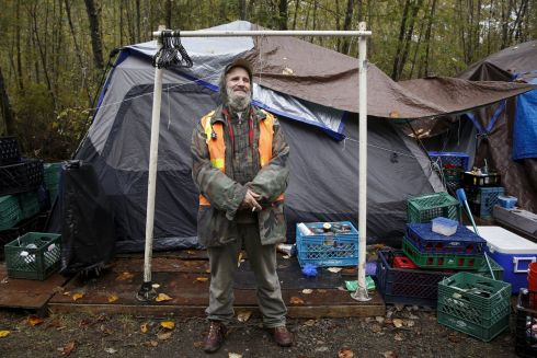 "Buzz Chevara, 56, poses in front of his tent at SHARE/WHEEL Tent City 4 outside Seattle, Washington October 9, 2015. ""The concept of tent city means community, safety and a place to be where nobody is going to harass or hurt you in the middle of the night,"" Chevara said.  Photograph: Shannon Stapleton /Reuters"