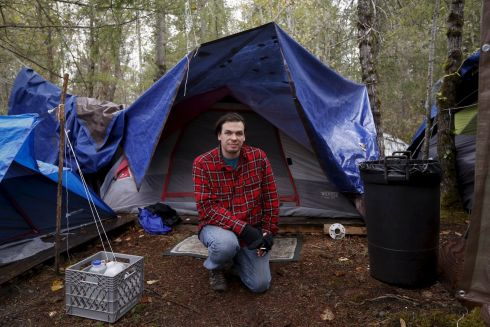 Stephan Schleicher, 31, poses in front of his tent at SHARE/WHEEL Tent City 4 outside Seattle, Washington October 9, 2015.  Photograph: Shannon Stapleton /Reuters
