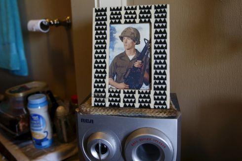 A photograph in a home at Quixote Village in Olympia, Washington. Quixote Village is made up of 30 cottages, a community building with a kitchen, showers and laundry facilities and a vegetable garden.  Photograph: Shannon Stapleton /Reuters