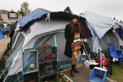 "Kalaniopua Young, 32, originally from Hawaii, poses outside her tent at SHARE/WHEEL Tent City 3 outside Seattle, Washington October 12, 2015. ""This is a choice I made to live here. I was lonely and depressed living in an apartment. I feel much better here with the social interaction and friendships..."" Photograph: Shannon Stapleton /Reuters"
