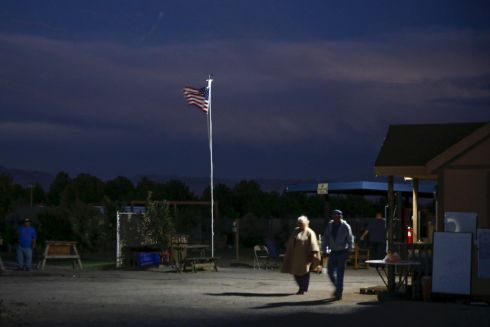 Residents walk at night at Camp Hope in Las Cruces, New Mexico. Photograph: Shannon Stapleton /Reuters