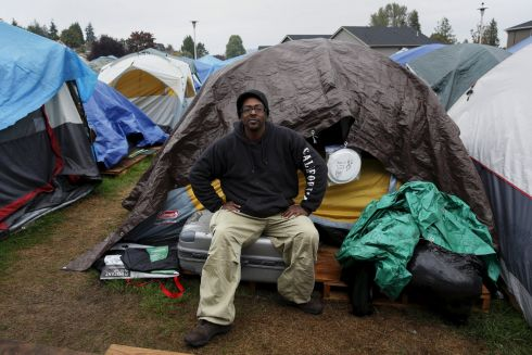"Aaron Ervin, 50, poses in front of his tent at SHARE/WHEEL Tent City 3 outside Seattle, Washington. ""Tent City has been a saving grace for me, a place for me to refresh and gather my thoughts. While I'm here I want to lead by example and be a positive influence on camp. People feel safe here, they are tense from being wrongfully judged from carrying all their bags as being homeless and the camp makes you feel comfortable knowing you have a safe place for your belongings, which does a lot for people making them more relaxed."" SHARE and WHEEL describe themselves as self-organised, democratic organisations of homeless and formally homeless people which run several self-managed tent cities.   Photograph: Shannon Stapleton /Reuters"