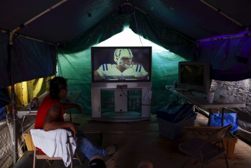 Tent city residents watch an NFL football game in their communal television area at SHARE/WHEEL Tent City 3 outside Seattle, Washington.  Photograph:Shannon Stapleton  /Reuters
