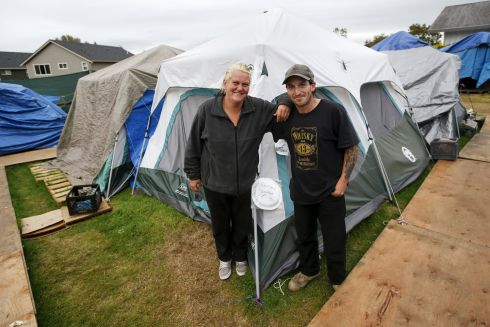 Shane Savage, 41, and his partner Jammie Nichols pose outside their tent at SHARE/WHEEL Tent City 3 outside Seattle, Washington.  Photograph: Shannon Stapleton /Reuters