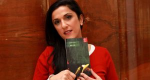 "Israeli author Dorit Rabinyan, posing with her Hebrew-language novel titled Gader Haya (known in English as Borderlife), expressed surprise at the controversy. ""Politicians keep using fear to do their bidding, but why?"" Photograph: Gil Cohen Magen/AFP/Getty Images"
