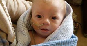 Noah Doyle, an 11-month-old who suffers from congenital heart disease.