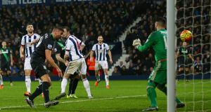 Jonathan Walters of Stoke City scores his team's first goal past Boaz Myhill of West Bromwich Albion. Photo: Michael Steele/Getty Images