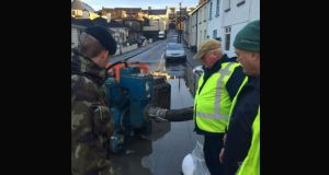 Irish Defence Forces help volunteers with pumps in Athlone on Sunday morning. Photograph: Irish Defence Forces/Twitter
