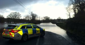 A road flooded on the Ballymacarberry side of Kilmanahan, Co. Waterford on Sunday. Photograph: An Garda Síochána/Twitter