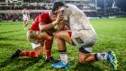 On their knees: Francis Saili of Munster and Nick Williams of Ulster pray at the end of their Pro12 clash in the Kingspan Stadium in Belfast. Photograph: James Crombie/Inpho