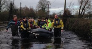 Simon Coveney visits Springfield in Co Clare on Sunday, where many residents have been forced from their homes due to flooding. Photograph: Simon Coveney/Twitter