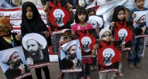 Shia Muslim children hold pictures of Sheikh Nimr al-Nimr, who was executed along with others in Saudi Arabia, during a protest rally  in Karachi, Pakistan, yesterday. Photograph: Akhtar Soomro/Reuters