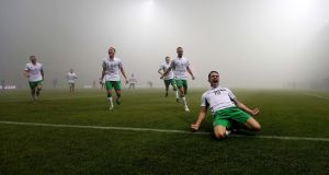 Robbie Brady celebrates scoring against Bosnia-Herzegovina: people watching on television were also enjoying jokes about the fog on social media. Photograph: Donall Farmer/Inpho