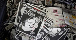 "The latest edition of French weekly newspaper Charlie Hebdo with the coverline: ""One year on,  assassin still on the run."" Photograph: Benoit Tessier/Reuters"