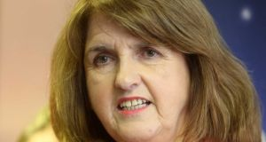 Tánaiste Joan Burton: says the Labour  Party will commit itself to split all available future resources between spending increases and tax cuts on a three-to-one basis in favour of spending. Photograph:  Sam Boal
