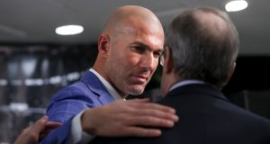 Real Madrid's new coach Zinedine Zidane embraces Real Madrid's President Florentino Perez at Santiago Bernabeu stadium in Madrid. Photograph: Juan Medina/Reuters