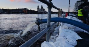 Sandbags along the  banks of the east side of the River Shannon at  Athlone  keep the river from flooding houses in the Strand Area. Photograph: Alan Betson/The Irish Times