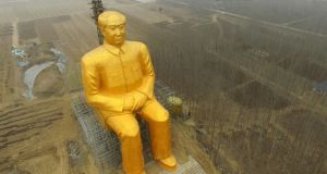 A huge statue of Chairman Mao Zedong under construction in Tongxu county in Kaifeng, central China's Henan province. Photograph: AFP/Getty Images