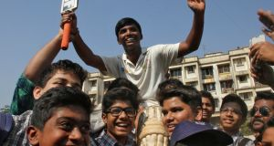 Pranav Dhanawade, 15, is lifted by his schoolmates after scoring 1,009 not out in an inter-school cricket tournament in Mumbai,  a new record score in a cricket match. Photograph:   Reuters