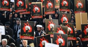 Iranians hold aloft posters of Shia cleric Nimr al-Nimr during an anti-Saudi Arabia demonstration at the Imam Hossein square in Tehran. Photograph: EPA