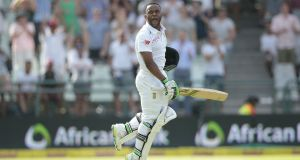 South African batsman Temba Bavuma celebrates after scoring  his first Test  century on  day  four  of the second Test against England at Cape Town. Photograph: Gianluigi Guercia/AFP/Getty Images