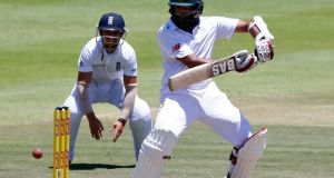 South Africa's Hashim Amla  plays a shot as England's James Taylor looks on during the second Test match in Cape Town, South Africa. Photograph: Mike Hutchings/Reuters