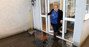 Liz O'Brien at her flood-damaged home  at Kilganey, Clonmel. Minister for Agriculture Simon Coveney said there is a number of  ways homeowners can  claim funds for flood damage relief.  Photograph: Eric Luke/The Irish Times