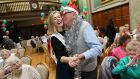 Rose of Tralee Elysha Brennan dances with Paddy Pugh at   the annual Royal College of Surgeons in Ireland Christmas lunch for senior citizens last month.
