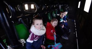 The Turley children from Golden Island Athlone onboard an Army truck going to school: Derbhla (9), Evan (7), Finian (6), and Gemma (4). Photograph: Bryan O'Brien