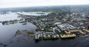 Flooding in Athlone. Major insurance companies  must do more for those who have been flooded, Taoiseach Enda Kenny has said. Photograph: Irish Air Corps