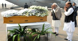 India's prime minister Narendra Modi and home minister Rajnath Singh stand before a casket containing the body of chief minister of the Indian state of Jammu and Kashmir, Mufti Mohammad Sayeed, at Palam Airport in New Delhi, on Thursday. Photograph: EPA/Indian Press Information Bureau