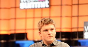 John Collison of Stripe speaking at the Web Summit in the RDS Dublin: the mobile payments  firm is moving into a Dublin's docklands building. Photograph: Eric Luke