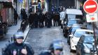 "French police near the Rue de la Goutte d'Or in north Paris on Thursday, after police shot dead a knife-wielding man who reportedly shouted ""Allahu Akbar"" (God is greatest). Photograph: Lionel Bonaventure/AFP/Getty Images"