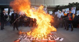 South Korean protesters burn an effigy of North Korea leader Kim Jong-Un during a  rally against development of nuclear weapons on January 7th, 2016 in Seoul, South Korea. Photograph: Chung Sung-Jun/Getty Images